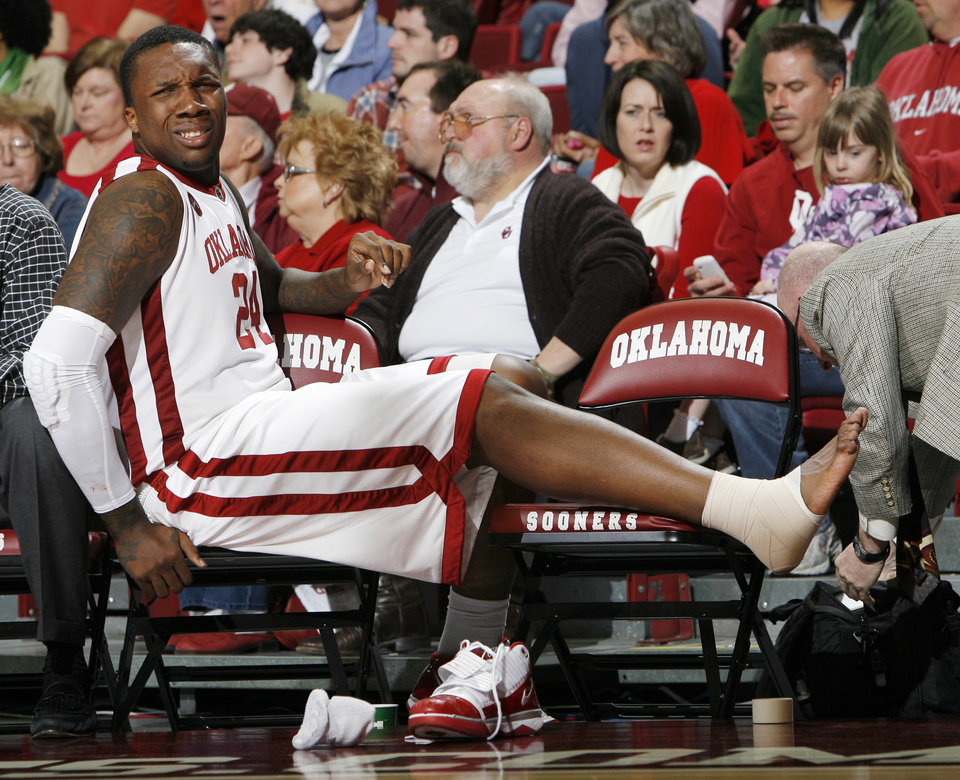 OU\'s Tiny Gallon (24) has his foot attended to after being hurt on a play in the second half during the men\'s college basketball game between the Oklahoma Sooners and Texas A&M Aggies at Lloyd Noble Center in Norman, Okla., Saturday, March 6, 2010. Texas A&M won, 69-54. Photo by Nate Billings, The Oklahoman
