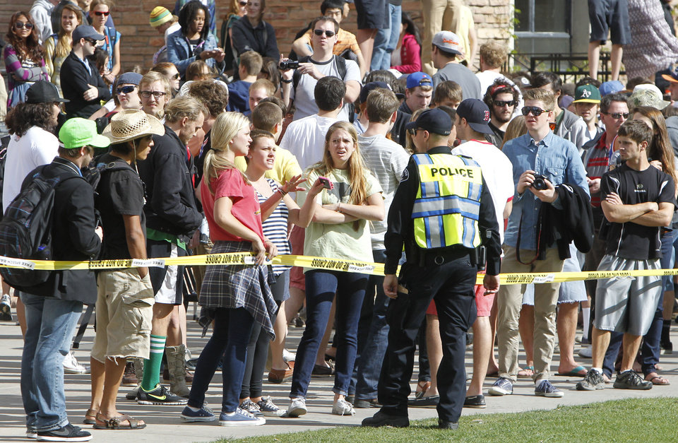 Photo -   A sheriff's deputy talks to students behind police barrier on the Norlin Quad at the University of Colorado in Boulder, Colo., on Friday, April 20, 2012, at 4:20pm. Police blocked off the quad to prevent a 420 marijuana smoke out. (AP Photo/Ed Andrieski)