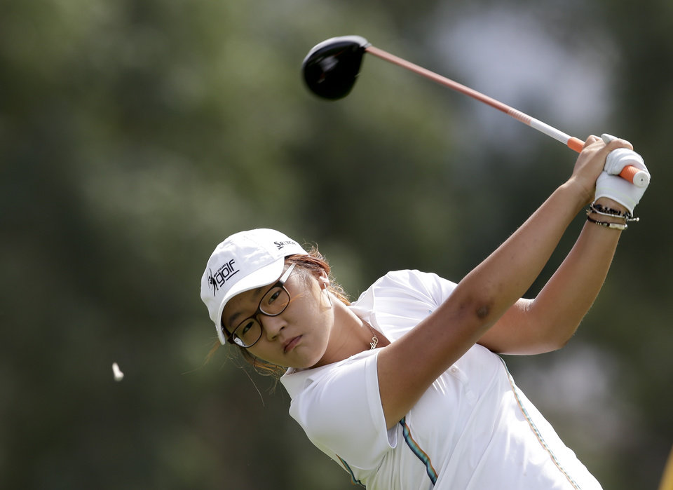 Lydia Ko, of New Zealand, hits on the sixth tee during the second round of the LPGA Kraft Nabisco Championship golf tournament in Rancho Mirage, Calif., Friday, April 5, 2013. (AP Photo/Chris Carlson)