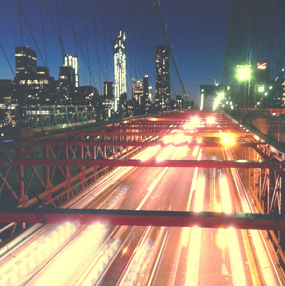 A photo by travel photographer John Barnett taken with the Slow Shutter application and edited with Wood Camera shows headlight trails along the Brooklyn Bridge. PHOTO PROVIDED. <strong></strong>