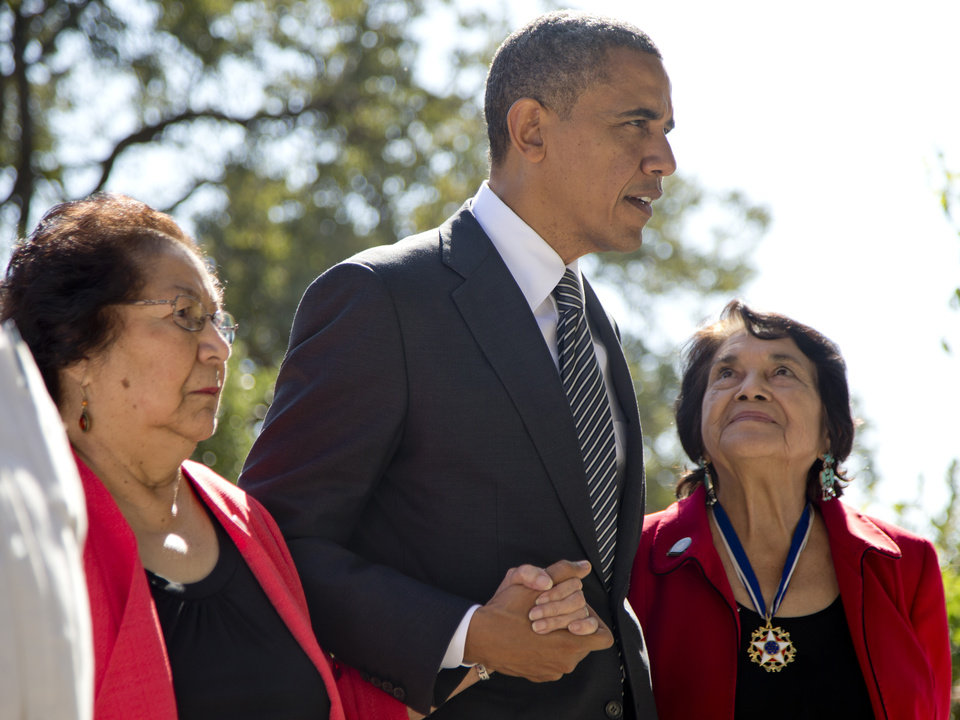 President Barack Obama walks with Cesar Chavez\' widow Helen F. Chavez, left, and Dolores Huerta, Co-Founder of the United Farm Workers, as they tour the Cesar E. Chavez National Monument Memorial Garden, Monday, Oct. 8, 2012, in Keene, Calif. (AP Photo/Carolyn Kaster)
