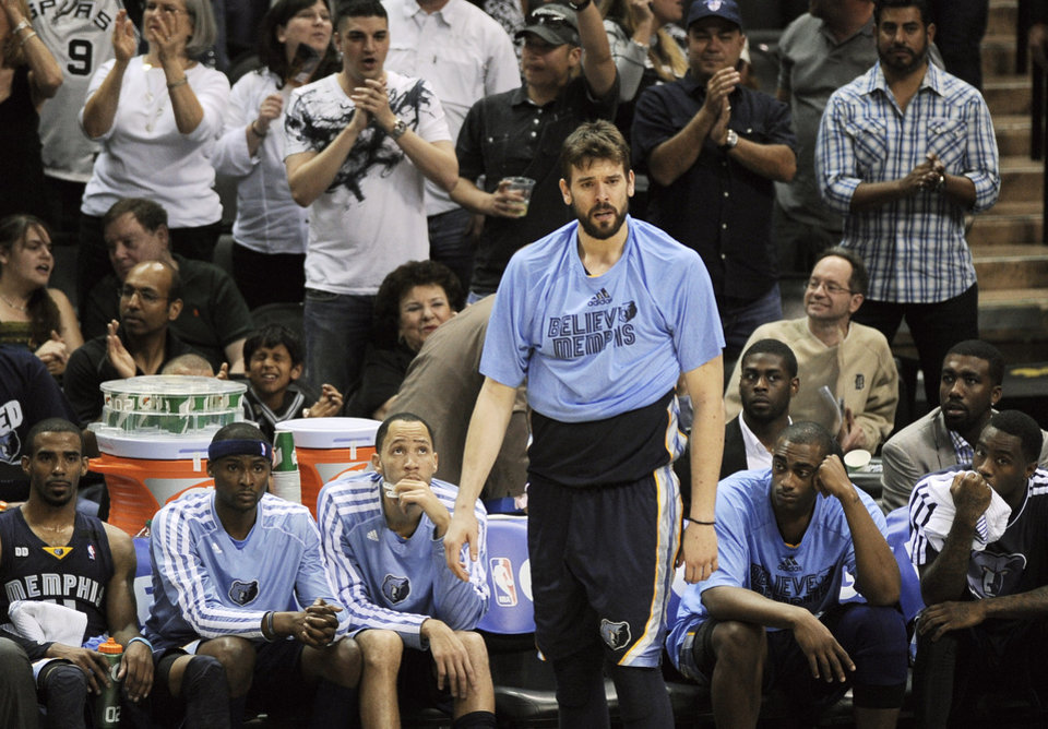 Photo - Memphis Grizzlies' Marc Gasol, center, of Spain, reacts to a San Antonio Spurs basket during the closing seconds of Game 1 of the Western Conference final NBA basketball playoff series, Sunday, May 19, 2013, in San Antonio. San Antonio won 105-83. (AP Photo/Darren Abate)