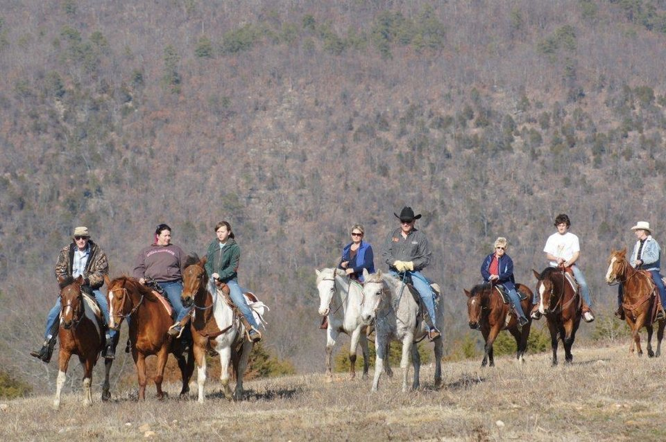 Photo - Visitors to the Buffalo Creek Ranch near Talihina in southeastern Oklahoma ride horses. Photo provided