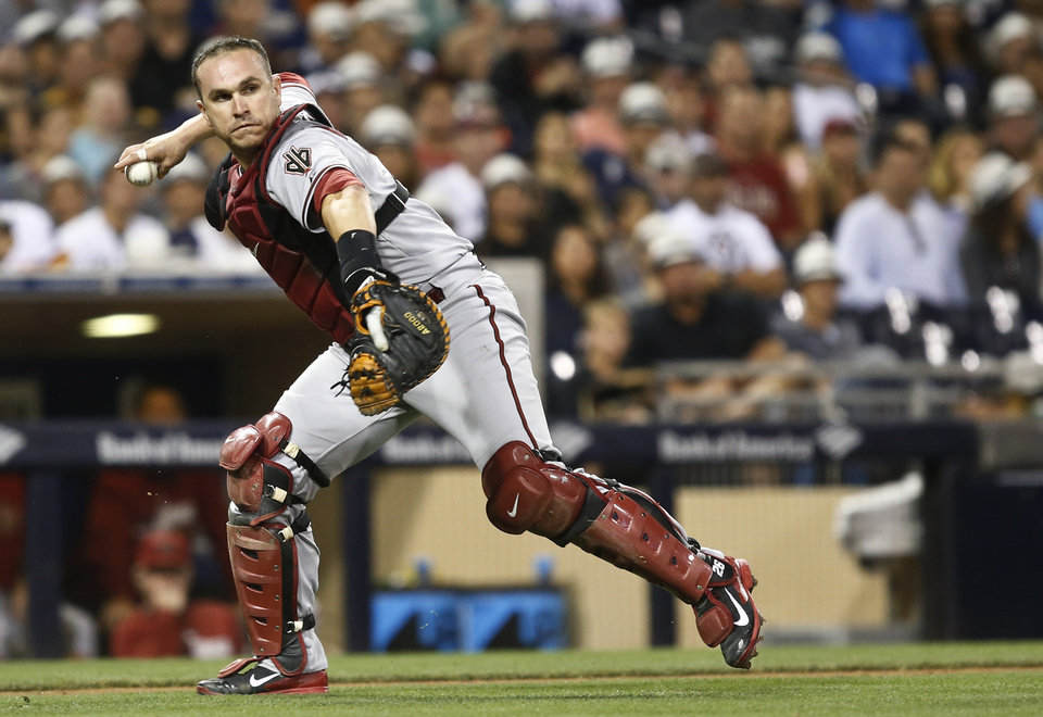 Photo - Arizona Diamondbacks catcher Miguel Montero throws to first for the out on San Diego Padres' Everth Cabrera during the sixth inning of a baseball game  Saturday, June 28, 2014, in San Diego. (AP Photo/Lenny Ignelzi)
