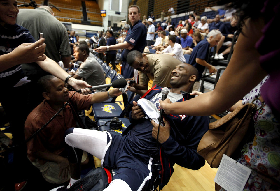 Photo -   U.S. men's national basketball team guard Kobe Bryant laughs during a media availability before a practice Sunday, July 15, 2012, in Washington. (AP Photo/Alex Brandon)