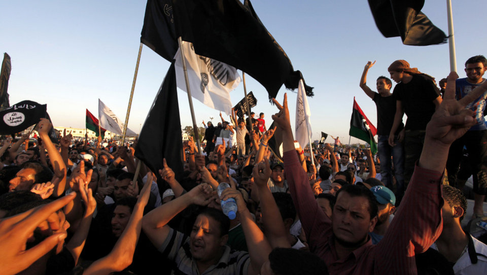 Libyan followers of Ansar al-Shariah Brigades and other Islamic militias hold a demonstration in Victory Square, against a film and a cartoon denigrating the Prophet Muhammad in Benghazi, Libya, Friday, Sept. 21, 2012. The attack that killed the U.S. ambassador and three other Americans has sparked a backlash among frustrated Libyans against the heavily armed gunmen, including Islamic extremists, who run rampant in their cities. more than 10,000 people poured into a main boulevard of Benghazi, demanding that militias disband as the public tries to do what Libya's weak central government has been unable to. AP photo