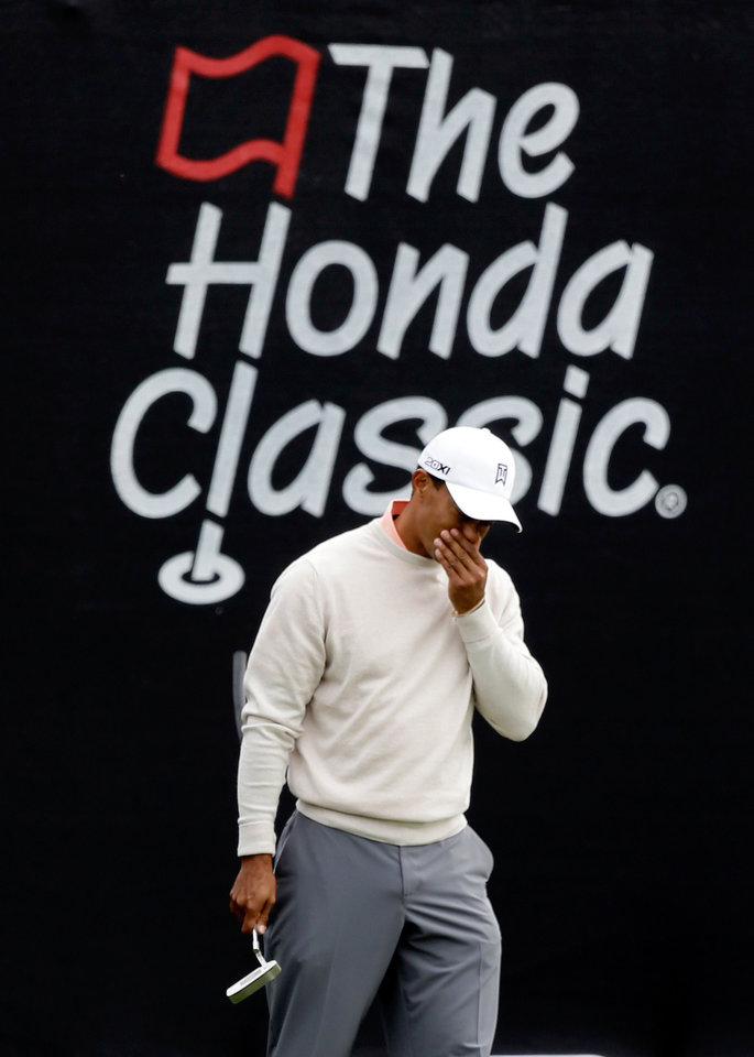 Photo - Tiger woods reacts to a shot on the 16th hole during the first round of the Honda Classic golf tournament, Thursday, Feb. 28, 2013, in Palm Beach Gardens, Fla. (AP Photo/Wilfredo Lee)