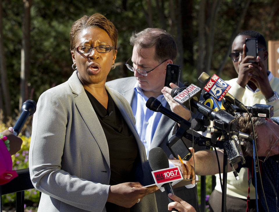 Photo -   Fulton County Police spokeswoman Cpl. Kay Lester speaks to reporters outside the World Changers International church in College Park, Ga., after a fatal shooting inside Wednesday, Oct. 24, 2012. Police say a volunteer leading a prayer service was shot and killed by a former church employee. (AP Photo/John Bazemore)
