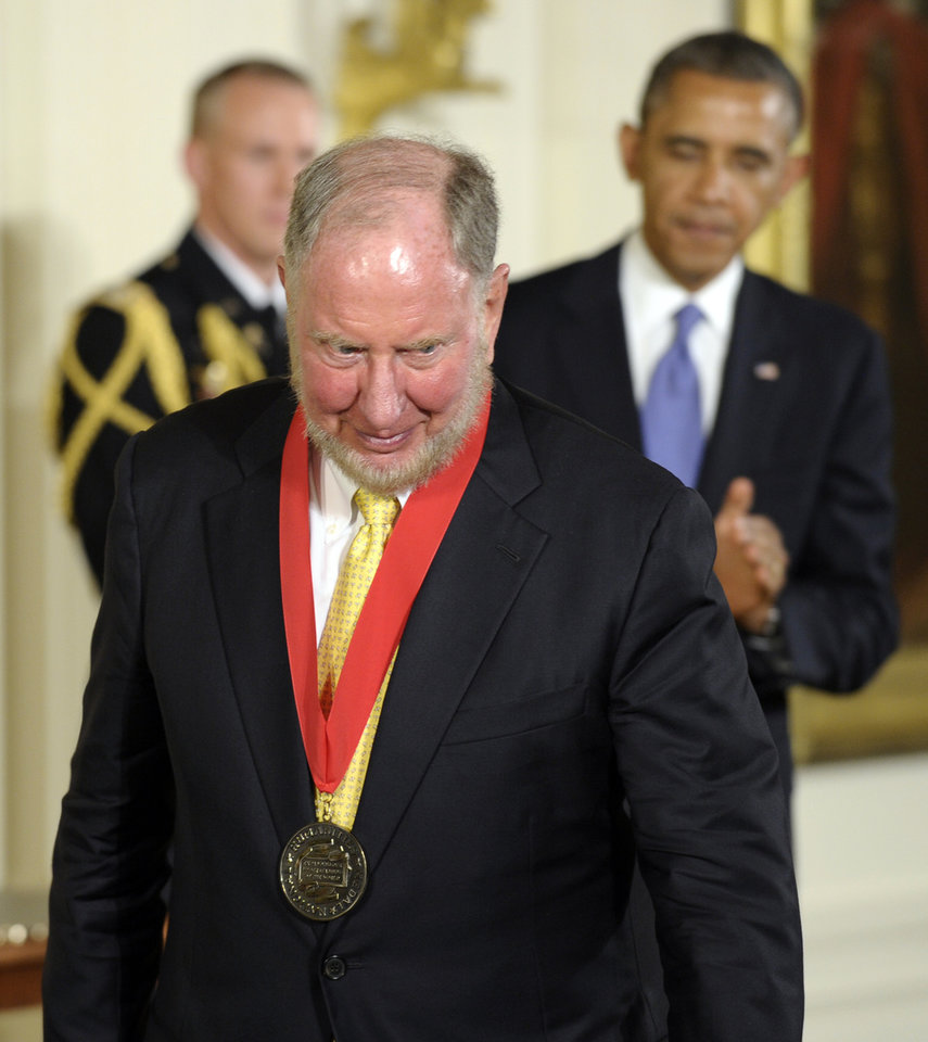 Photo - President Barack Obama watches as  Robert Putnam walks off of the stage after presenting him with the 2012 National Humanities Medal during a ceremony in the East Room of White House in Washington, Wednesday, July 10, 2013. (AP Photo/Susan Walsh)
