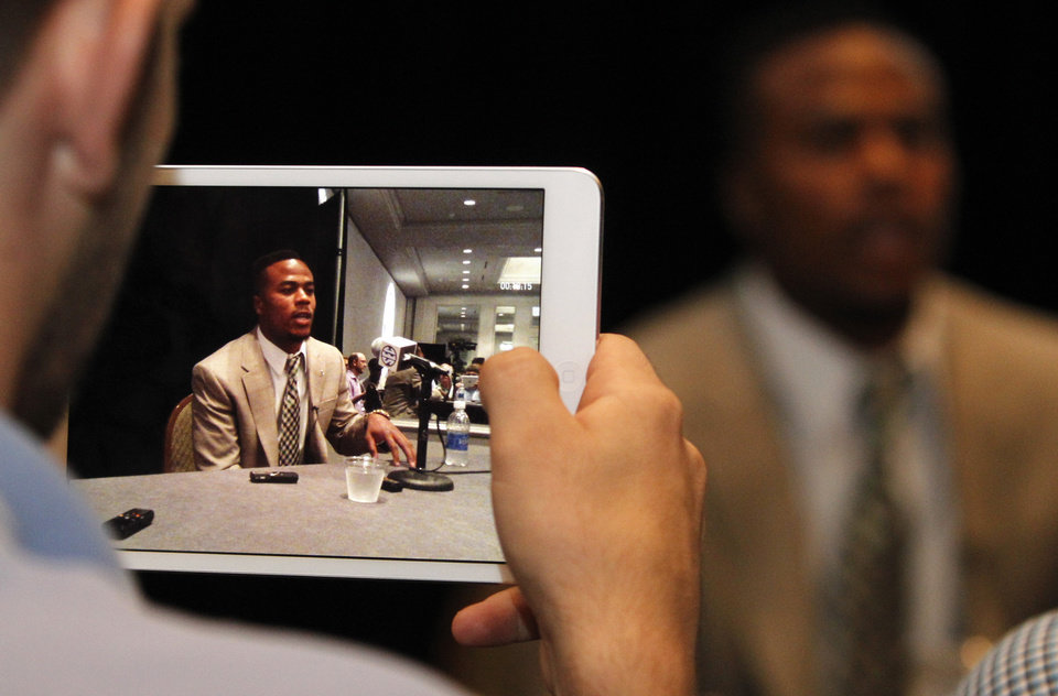 Photo - Alabama wide receiver Christion Jones, displayed on a tablet device, speaks to the media at the Southeastern Conference NCAA college football media days Thursday, July 17, 2014, in Hoover, Ala. (AP Photo/Butch Dill)