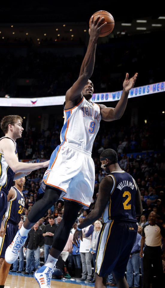 Photo - Oklahoma City's Serge Ibaka (9) shoots a lay up during the NBA game between the Oklahoma City Thunder and the Utah Jazz at the Chesapeake Energy Arena, Sunday, Nov. 24, 2013. Photo by Sarah Phipps, The Oklahoman