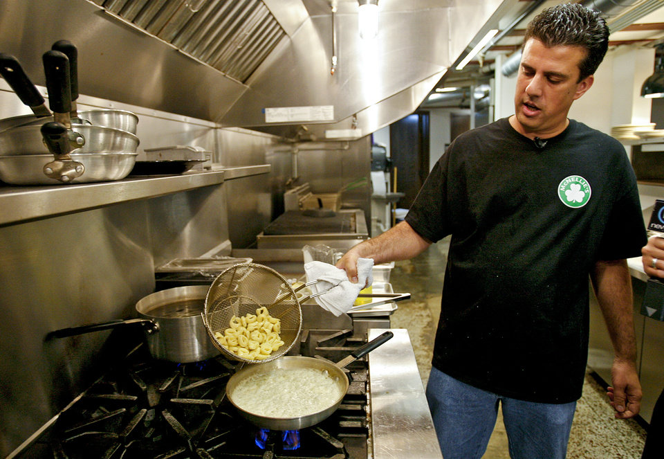 Photo - Chef Steven Paizis prepares a dish in the kitchen at the new McNellie's Pub on Wednesday, June 25, 2008, in Oklahoma City, Okla.   Staff Photo By Chris Landsberger   ORG XMIT: KOD