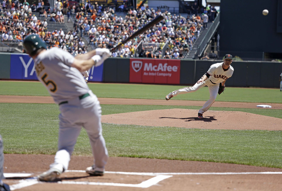 Photo - Oakland Athletics' John Jaso singles off San Francisco Giants starting pitcher Tim Hudson in the first inning of their interleague baseball game Thursday, July 10, 2014, in San Francisco. (AP Photo/Eric Risberg)