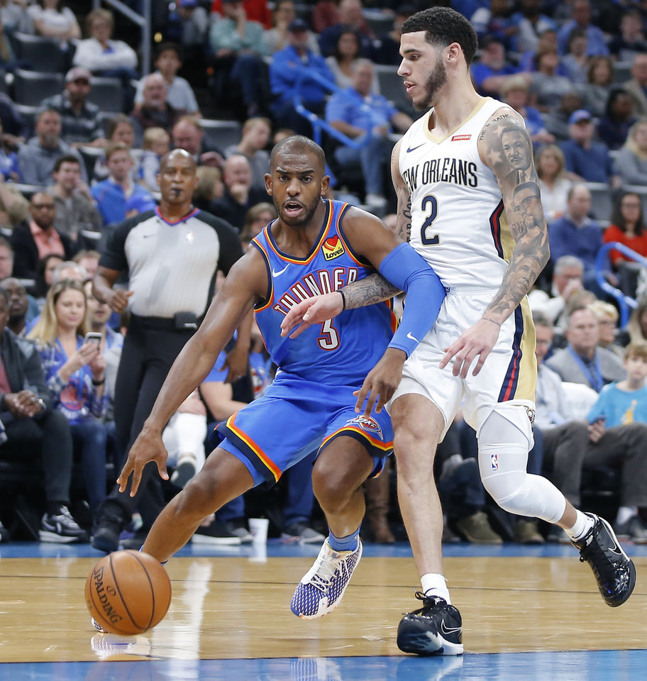 Photo - Oklahoma City's Chris Paul (3) goes past New Orleans' Lonzo Ball (2) during an NBA basketball game between the Oklahoma City Thunder and the New Orleans Pelicans at Chesapeake Energy Arena in Oklahoma City, Saturday, Nov. 2, 2019. Oklahoma City won 115-104. [Bryan Terry/The Oklahoman]
