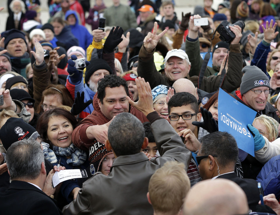 Photo -   FILE - In this Thursday, Nov. 1, 2012 file photo, President Barack Obama greets supporters during a campaign stop at Austin Straubel International Airport in Green Bay, Wis. Kiss by kiss, handshake by handshake, Obama glides across the perimeter of a small tennis stadium, stooping over to embrace white-haired retirees wearing dark sunglasses and extending his arms to shake hands or touch the masses a few rows back. (AP Photo/Pablo Martinez Monsivais, File)