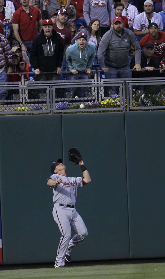 Photo - Washington Nationals' Tyler Moore fields a sacrifice fly hit by Philadelphia Phillies' Ben Revere for an out in the third inning of a baseball game on Friday, May 2, 2014, in Philadelphia. (AP Photo/Laurence Kesterson)