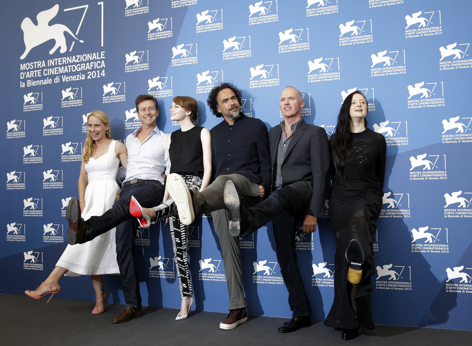 Photo - From left, actors Amy Ryan, Edward Norton, Emma Stone, director Alejandro Gonzalez Inarritu, actors Michael Keaton and Andrea Riseborough pose for photographers during a photo call for Birdman at 71st edition of the Venice Film Festival in Venice, Italy, Wednesday, Aug. 27, 2014. (AP Photo/David Azia)