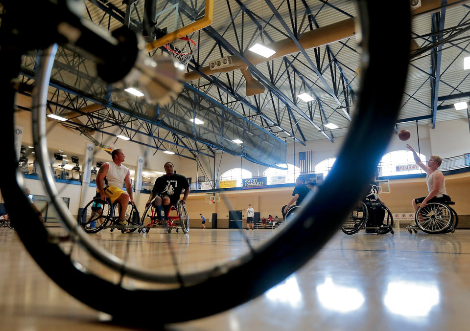 Teams hit the hardwood for the three on three basketball game during the Endeavor Games at the University of Central Oklahoma on Friday, June 7, 2013 in Edmond, Okla. Photo by Chris Landsberger, The Oklahoman