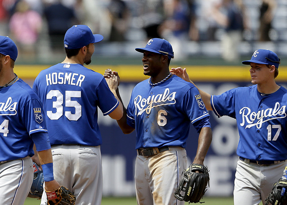 Kansas City Royals' Lorenzo Cain, center, high-fives teammate Eric Hosmer, left, after the Royals defeated the Atlanta Braves 1-0 in a baseball game, Wednesday, April 17, 2013, in Atlanta. (AP Photo/David Goldman)