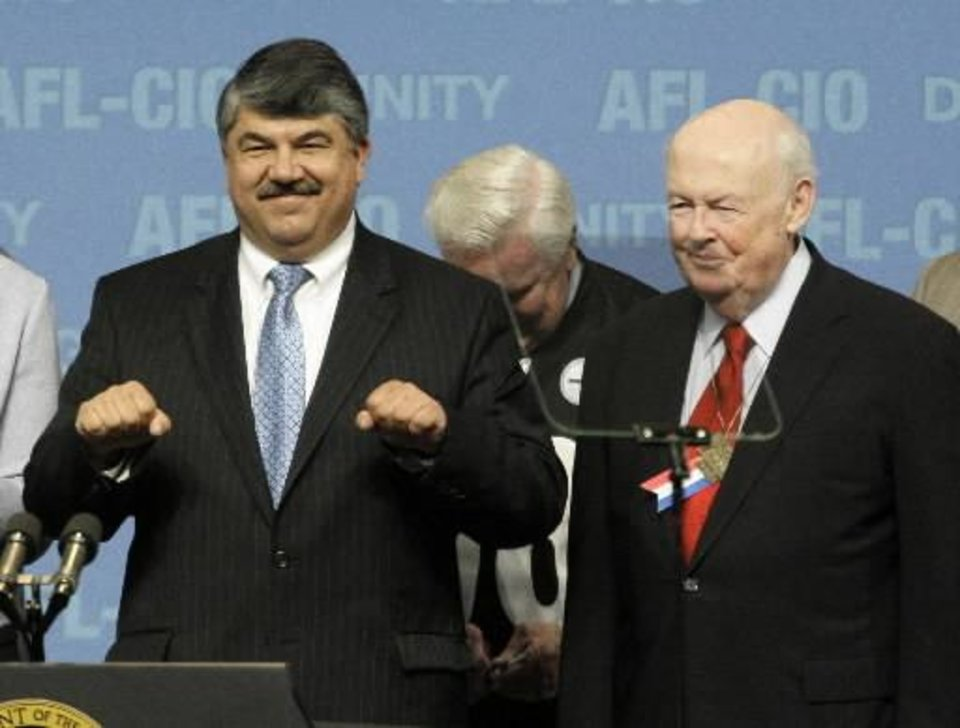 Photo - In this Sept. 15, 2009 photo, then,  AFL- CIO Secretary-Treasurer Richard Trumka, left, stands with  AFL- CIO President John J. Sweeney, right, after hearing President Barack Obama address the delegates attending the  AFL- CIO convention in Pittsburgh. Union members have formally elected Richard Trumka as the  AFL- CIO's first new president in 14 years Wednesday, Sept. 16. (AP Photo/Gene J. Puskar)