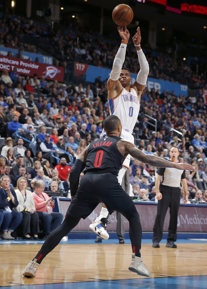 Photo - Oklahoma City's Russell Westbrook (0) shoots over Portland's Damian Lillard (0) during the NBA basketball game between the Oklahoma City Thunder and the Portland Trail Blazers at Chesapeake Energy Arena in Oklahoma City, Tuesday, Jan. 22, 2019. Photo by Sarah Phipps, The Oklahoman