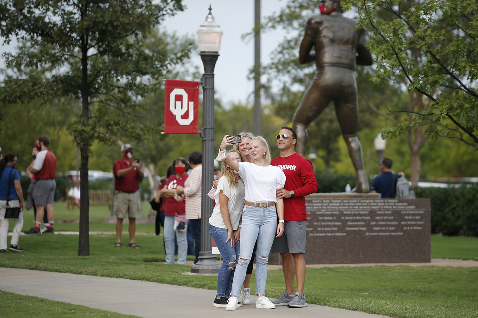 Photo - Fans take photos outside Gaylord Family-Oklahoma Memorial Stadium before a college football game between the University of Oklahoma Sooners (OU) and Missouri State in Norman, Okla., Saturday, Sept. 12, 2020. [Bryan Terry/The Oklahoman]