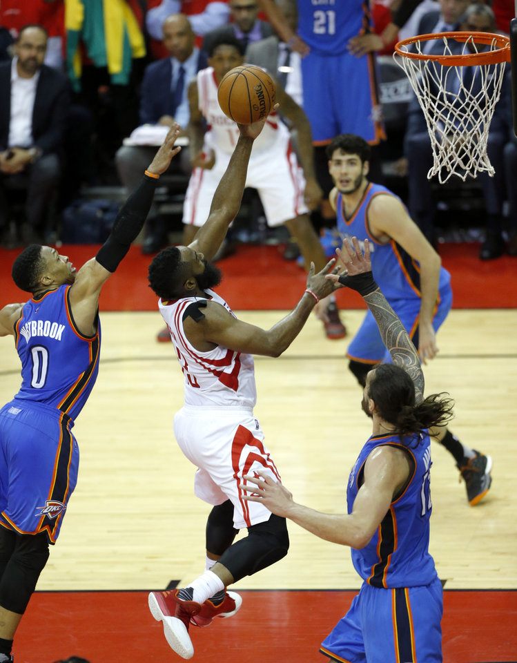 Photo - Houston's James Harden (13) shoots a lay up as Oklahoma City's Russell Westbrook (0) defends during Game 5 in the first round of the NBA playoffs between the Oklahoma City Thunder and the Houston Rockets in Houston, Texas,  Tuesday, April 25, 2017.  Houston won 105-99. Photo by Sarah Phipps, The Oklahoman