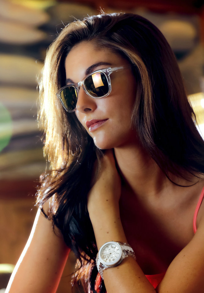 Photo - Model Kimber wears Carrera clear sunglasses and a clear Michael Kors watch from Dillard's, Penn Square Mall. Photo by Chris Landsberger, The Oklahoman  CHRIS LANDSBERGER