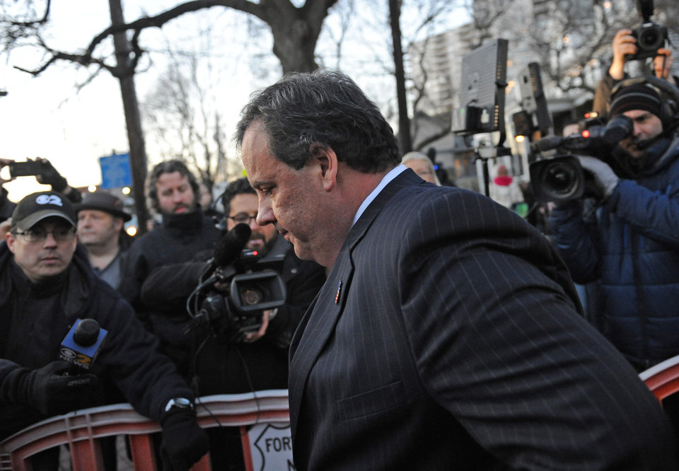 Photo - New Jersey Gov. Chris Christie walks past reporters as he leaves City Hall Thursday, Jan. 9, 2014, in Fort Lee, N.J. Christie traveled to Fort Lee to apologize in person to Mayor Mark Sokolich. Moving quickly to contain a widening political scandal, Gov. Chris Christie fired one of his top aides Thursday and apologized repeatedly for the