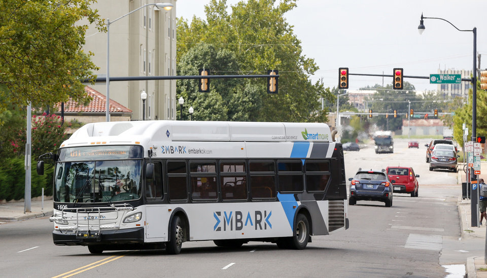 Photo -  An EMBARK bus turns on NW 4 St., leaving the Transit Center in downtown Oklahoma City, Friday, Sept. 13, 2019. [Nate Billings/The Oklahoman]