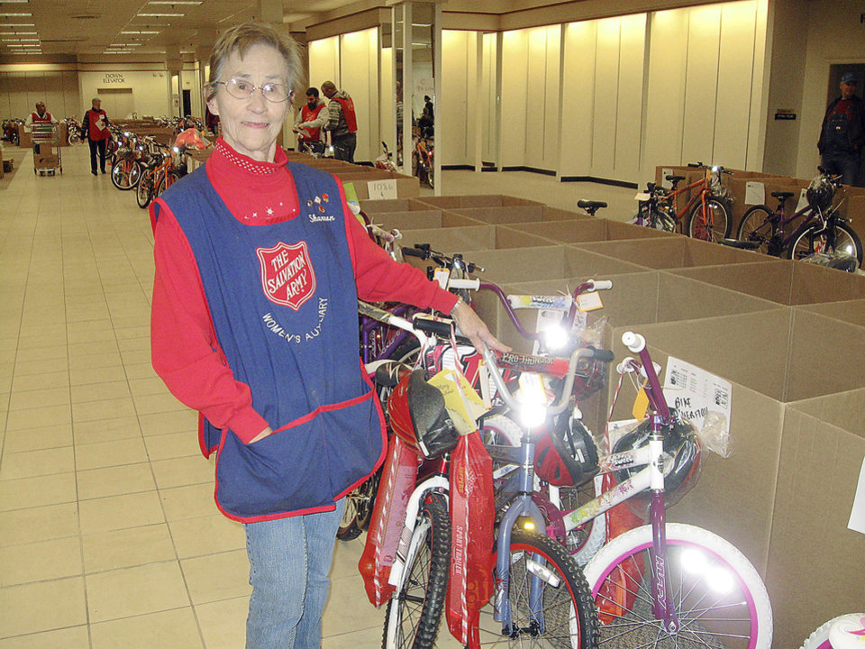 Salvation Army Women�s Auxiliary member Sharron Ashton, of Del City, is known as the �box lady� for her tedious work organizing the more than 1,300 30 inches-by-30 inches boxes that held donated Angel Tree Christmas gifts for area families.  PHOTO PY PAULA BURKES, THE OKLAHOMAN