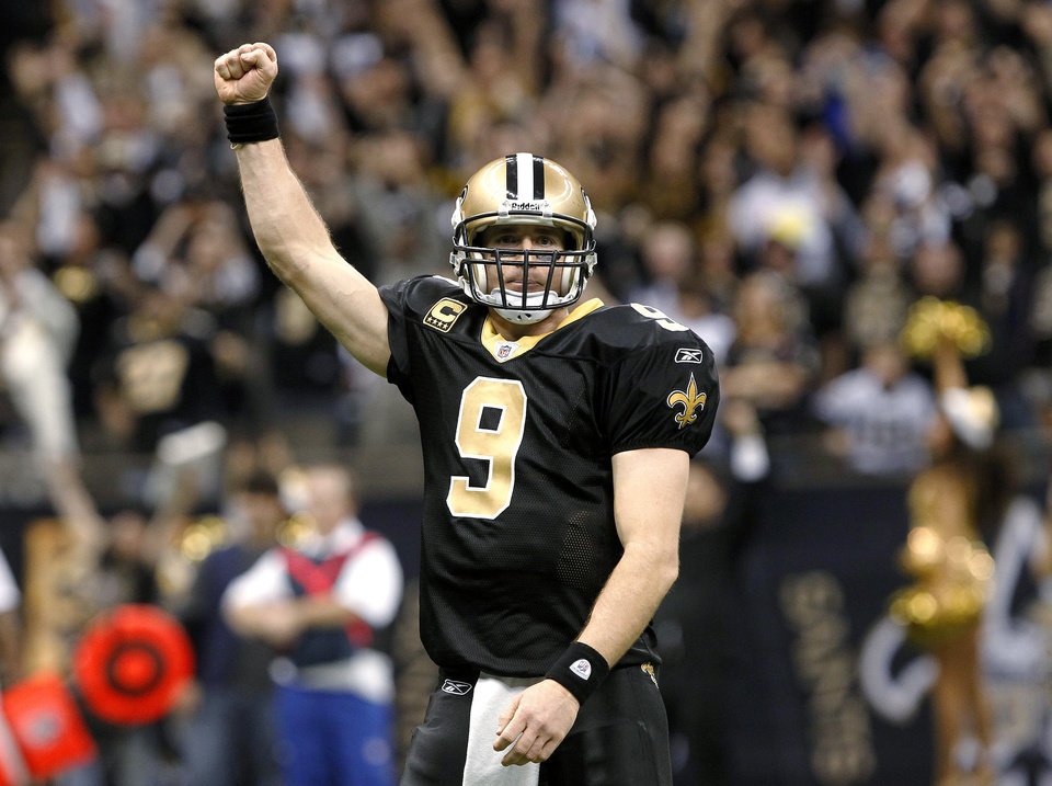 Photo -   FILE - In this Dec. 26, 2011, file photo, New Orleans Saints quarterback Drew Brees celebrates after throwing a touchdown pass and breaking the NFL single-season record for passing yardage, held by Dan Marino, in the fourth quarter of an NFL football game against the Atlanta Falcons in New Orleans. Brees has agreed to a five-year, $100 million contract with the Saints, with $60 million guaranteed, on Friday, July 13, 2012, a person familiar with the deal tells The Associated Press. (AP Photo/Rusty Costanza, File)