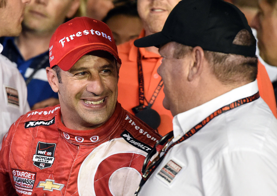 Photo - Tony Kanaan celebrates with team owner Chip Ganassi after winning the IndyCar Series season final 500 mile auto race Saturday, Aug. 30, 2014, at Auto Club Speedway, in Fontana, Calif. (AP Photo/Will Lester)