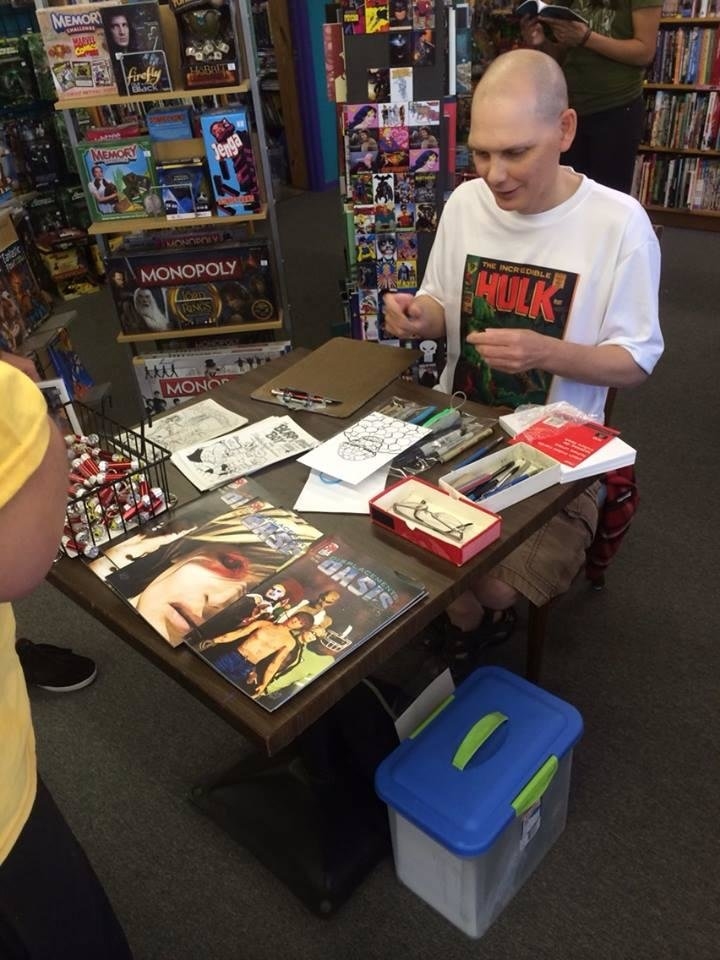 Photo -  S.A. McClung signs at Speeding Bullet Comics on Free Comic Book Day 2014.