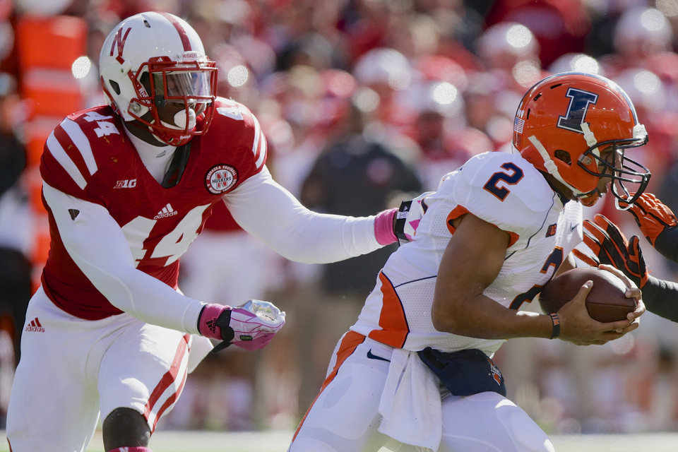 Photo - FILE - In this Oct. 5, 2013, file photo, Nebraska defensive end Randy Gregory (44) pursues and later sacks Illinois quarterback Nathan Scheelhaase (2) in an NCAA college football game in Lincoln, Neb. Following practice on Wednesday, March 12, 2014, Neb. coach Bo Pelini said that Gregory hasn't even scratched the surface of what he's going to become, what he's going to be. (AP Photo/Nati Harnik, File)