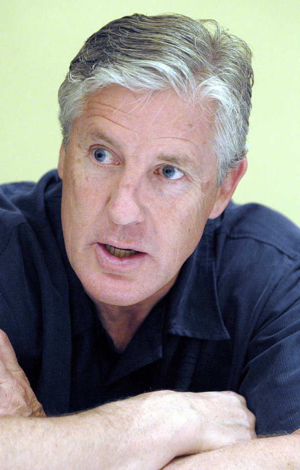 Photo - Seattle Seahawks head football coach Pete Carroll answers questions from reporters during an early morning question-and-answer session during the NFL meetings in Orlando, Fla., Wednesday, March 24, 2010. (AP Photo/Phelan M. Ebenhack) ORG XMIT: FLPE101