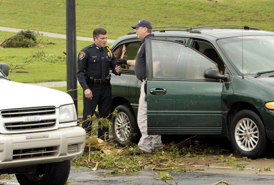 City Employees\' automobiles were moved by the wind and struck by trees in the parking lot of the Norman Police Department from a reported tornado that struck the west and central pars of town on Friday, April 13, 2012, in Norman, Okla. Photo by Steve Sisney, The Oklahoman