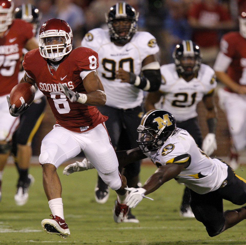 Photo - Oklahoma's Dominique Whaley (8) leaps past Missouri's Kenji Jackson (13)during the college football game between the University of Oklahoma Sooners (OU) and the University of Missouri Tigers (MU) at the Gaylord Family-Memorial Stadium on Saturday, Sept. 24, 2011, in Norman, Okla. Photo by Bryan Terry, The Oklahoman
