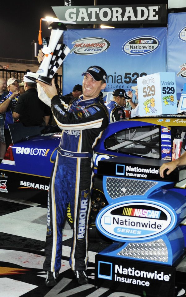 Photo -   Kevin Harvick holds the trophy after he won the NASCAR Natiowide Series auto race at Richmond International Raceway in Richmond, Va., Friday, Sept. 7, 2012. (AP Photo/Clem Britt)