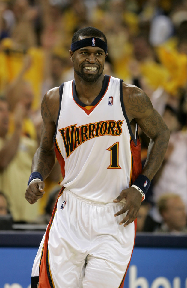 Photo - Golden State Warriors' Stephen Jackson smiles after making a basket against the Dallas Mavericks in the third quarter of an NBA Western Conference first-round basketball playoff game in Oakland, Calif., Thursday, May 3, 2007. The Warriors won 111-86. (AP Photo/Jeff Chiu) ORG XMIT: CAJC115
