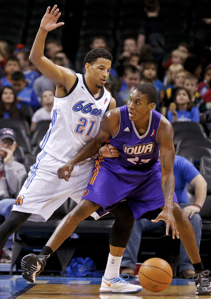 Photo - Tulsa's Andre Roberson (21) defends Iowa's Larry Owens (23) during the NBA Developmental game between the Tulsa 66ers and the Iowa Energy at the Chesapeake Energy Arena in Oklahoma City, Okla. on Tuesday, Feb. 4, 2014. Photo by Chris Landsberger, The Oklahoman
