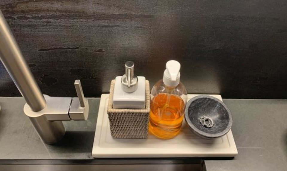 Photo -  Shazalynn Cavin-Winfrey, of SCW Interiors in Alexandria, Virginia, likes to use a small tray or platter that can hold soaps and lotions plus a ring dish. [SHAZALYNN CAVIN-WINFREY]