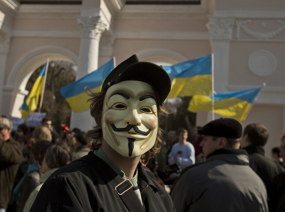 Photo - A pro-Ukrainian demonstrator wearing a mask attends a rally, in Simferopol, Ukraine, Saturday, March 15, 2014. Tensions are high in the Black Sea peninsula of Crimea, where a referendum is to be held Sunday on whether to split off from Ukraine and seek annexation by Russia. (AP Photo/Vadim Ghirda)