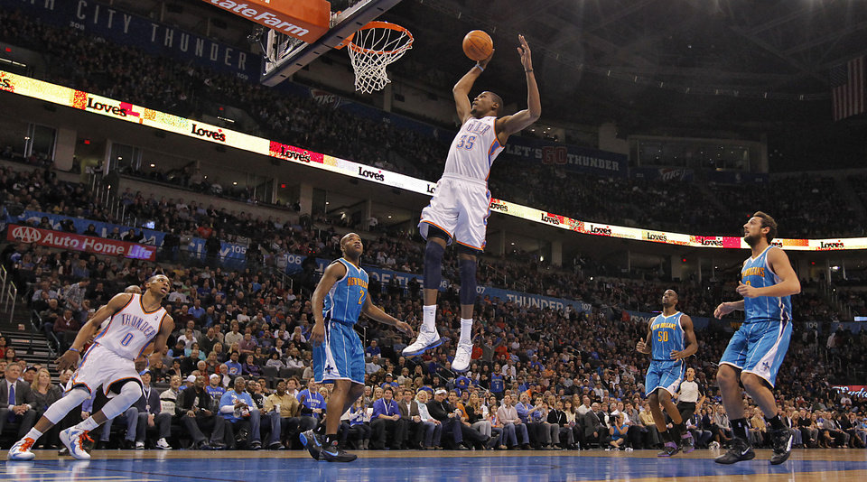 Photo - Oklahoma City Thunder small forward Kevin Durant (35) dunks the ball over New Orleans Hornets point guard Jarrett Jack (2) during the NBA basketball game between the Oklahoma City Thunder and the New Orleans Hornets at the Chesapeake Energy Arena on Wednesday, Jan. 25, 2012, in Oklahoma City, Okla. Photo by Chris Landsberger, The Oklahoman