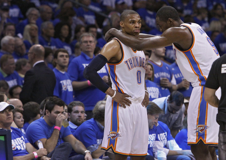 OKLAHOMA CITY ARENA: Oklahoma City\'s Russell Westbrook (0) and Oklahoma City\'s Serge Ibaka (9) talk after a timeout in the first half during game 3 of the Western Conference Finals of the NBA basketball playoffs between the Dallas Mavericks and the Oklahoma City Thunder at the OKC Arena in downtown Oklahoma City, Saturday, May 21, 2011. Photo by Chris Landsberger, The Oklahoman ORG XMIT: KOD