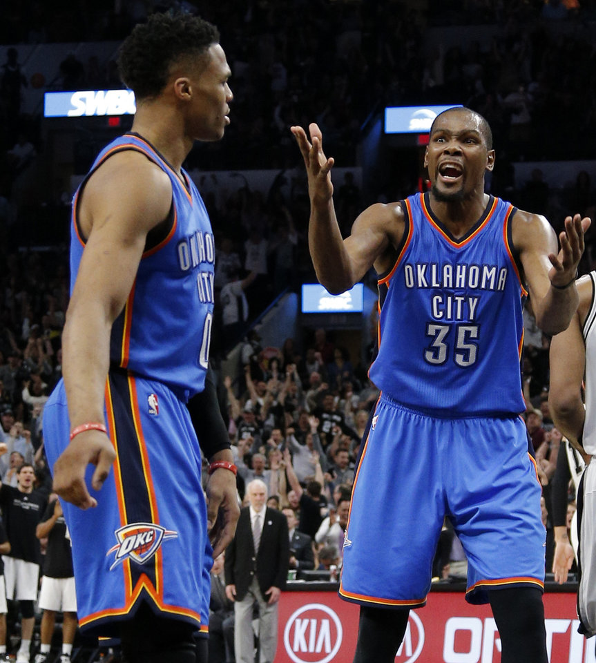 Photo - Oklahoma City's Kevin Durant (35) shouts at Russell Westbrook (0) during Game 2 of the second-round series between the Oklahoma City Thunder and the San Antonio Spurs in the NBA playoffs at the AT&T Center in San Antonio, Monday, May 2, 2016. Oklahoma City won 98-97. Photo by Bryan Terry, The Oklahoman