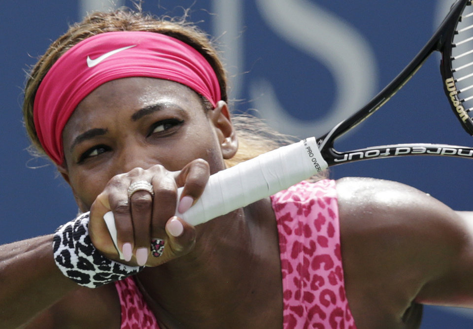 Photo - Serena Williams, of the United States, returns a shot against Kaia Kanepi, of Estonia, during the fourth round of the 2014 U.S. Open tennis tournament, Monday, Sept. 1, 2014, in New York. (AP Photo/Charles Krupa)