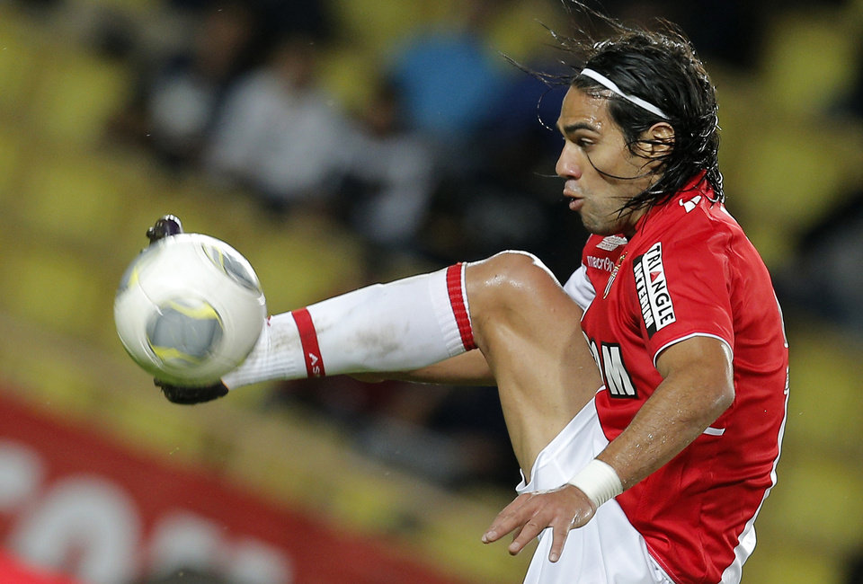 Photo - FILE - This is a Friday, Nov. 8, 2013 file photo of Monaco's  Radamel Falcao of Colombia controls the ball during his French League One soccer match against Evian, in Monaco stadium.  Monaco's Colombia striker l Falcao faces an anxious wait to find out if he has a serious knee injury after being taken off on a stretcher in the French Cup on Wednesday Jan. 22, 2014. (AP Photo/Lionel Cironneau, File)