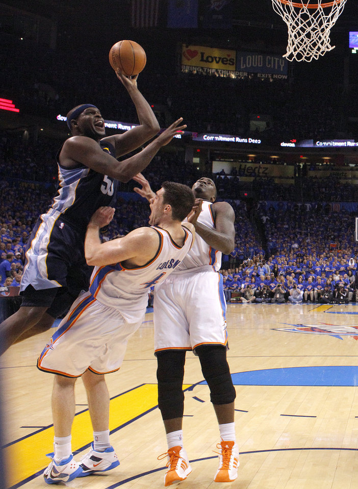 Oklahoma City\'s Nick Collison (4) draws a charge call on Zach Randolph (50) of Memphis as Oklahoma City\'s Kendrick Perkins (5) looks on during game 7 of the NBA basketball Western Conference semifinals between the Memphis Grizzlies and the Oklahoma City Thunder at the OKC Arena in Oklahoma City, Sunday, May 15, 2011. Photo by Sarah Phipps, The Oklahoman