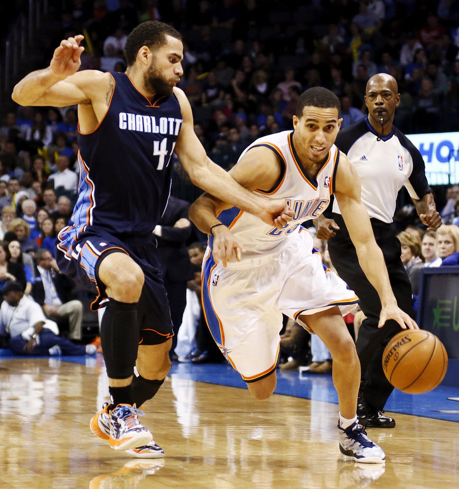 Oklahoma City's Kevin Martin (23) drives the ball against Charlotte's Jeffery Taylor (44) during an NBA basketball game between the Oklahoma City Thunder and Charlotte Bobcats at Chesapeake Energy Arena in Oklahoma City, Monday, Nov. 26, 2012.  Photo by Nate Billings , The Oklahoman